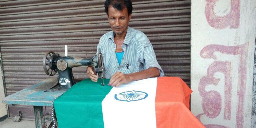 Tailors toil to meet huge demands for national flags