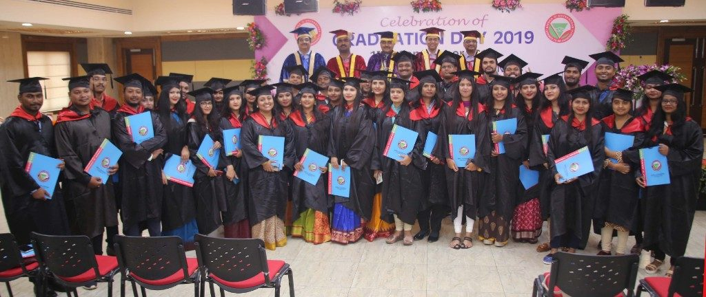 Management students receive degrees